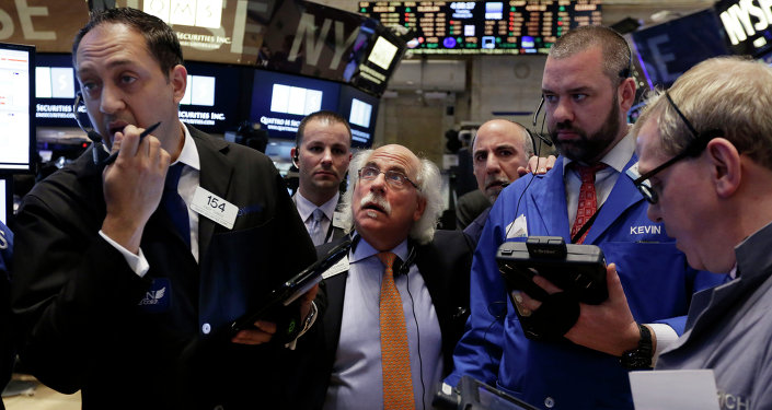 Traders gather at a post on the floor of the New York Stock Exchange,  Febuary 24, 2015