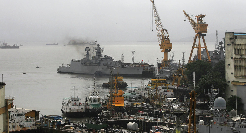Ships ride at anchors at a naval dockyard where a submarine caught fire and sank after an explosion early Wednesday in Mumbai, India. Flie photo
