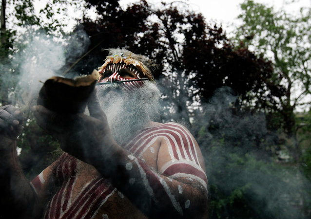 Aboriginal Ngarrindjeri elder Major Sumner from south Australia, in traditional costume, performs a ritual during a ceremony to mark the return of Australian indigenous people's remains back to their homeland, in a central London park
