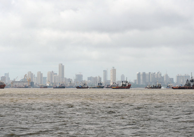 Ships are seen anchored in the Arabian sea following following the closure of the Mumbai port after a maritime accident involving the cargo ship MSC Chitra off the Mumbai coast on August 11, 2010