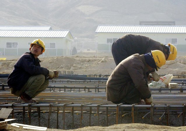North Korean workers construct a factory.