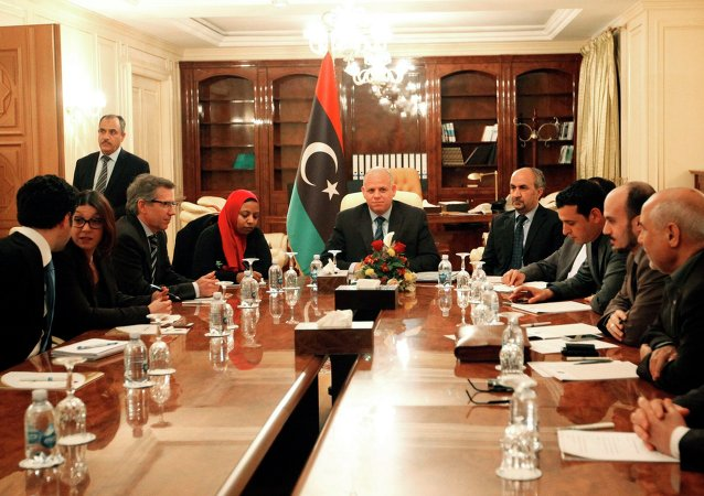 Bernardino Leon (3rd L), U.N. special envoy for Libya, attends a meeting with members of the Libyan General National Congress in Tripoli March 2, 2015