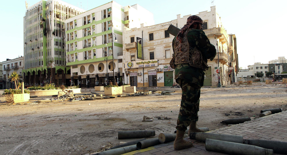 A Libyan soldier, loyal to Libya's internationally recognised government of Abdullah al-Thani and General Khalifa Haftar, patrols a street in the eastern coastal city of Benghazi on February 28, 2015