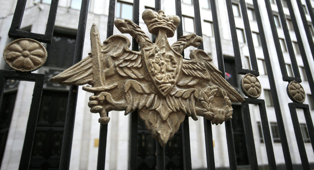 The emblem of the Russian Defense Ministry adorns the fence around the Defense Ministry's headquarters in Moscow, Russia, Thursday, Oct. 25, 2012