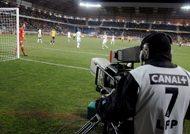 Canal+ staff filming football game in Sochaux, France