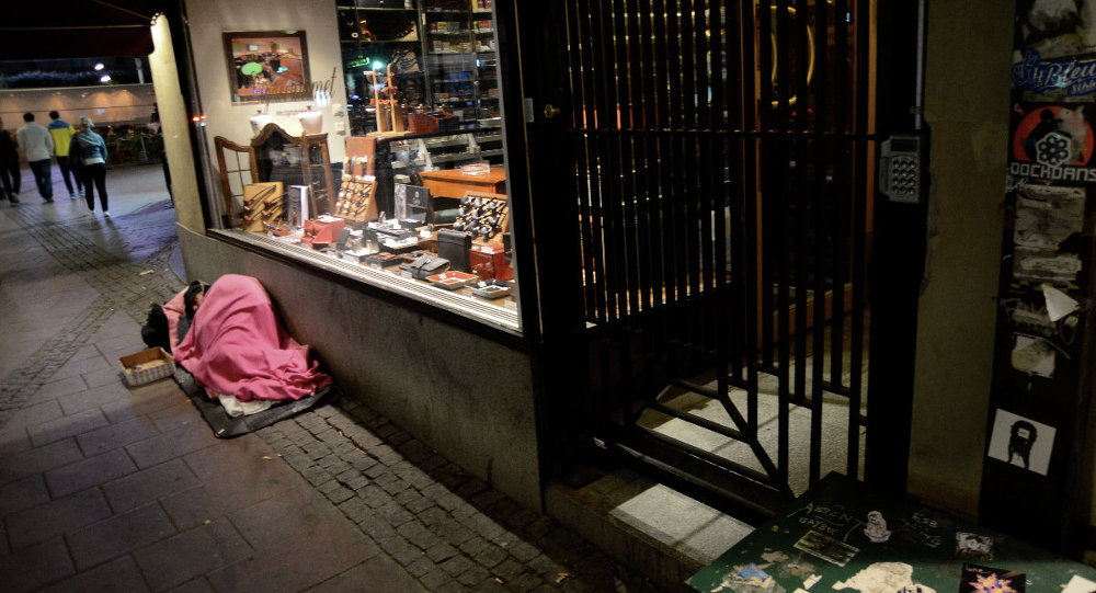 A Swedish art gallery has been harshly criticized for using two Roma beggars as props in its installation