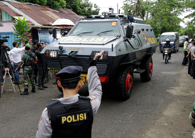 One of Indonesian police armored vehicles carrying two Australian prisoners arrives at Wijaya Pura port in Cilacap, Central Java, Indonesia, Wednesday, March 4, 2015