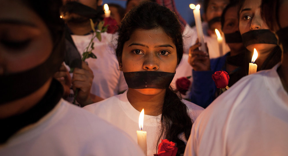 Indian women participate in a candle light vigil for Jyoti Singh