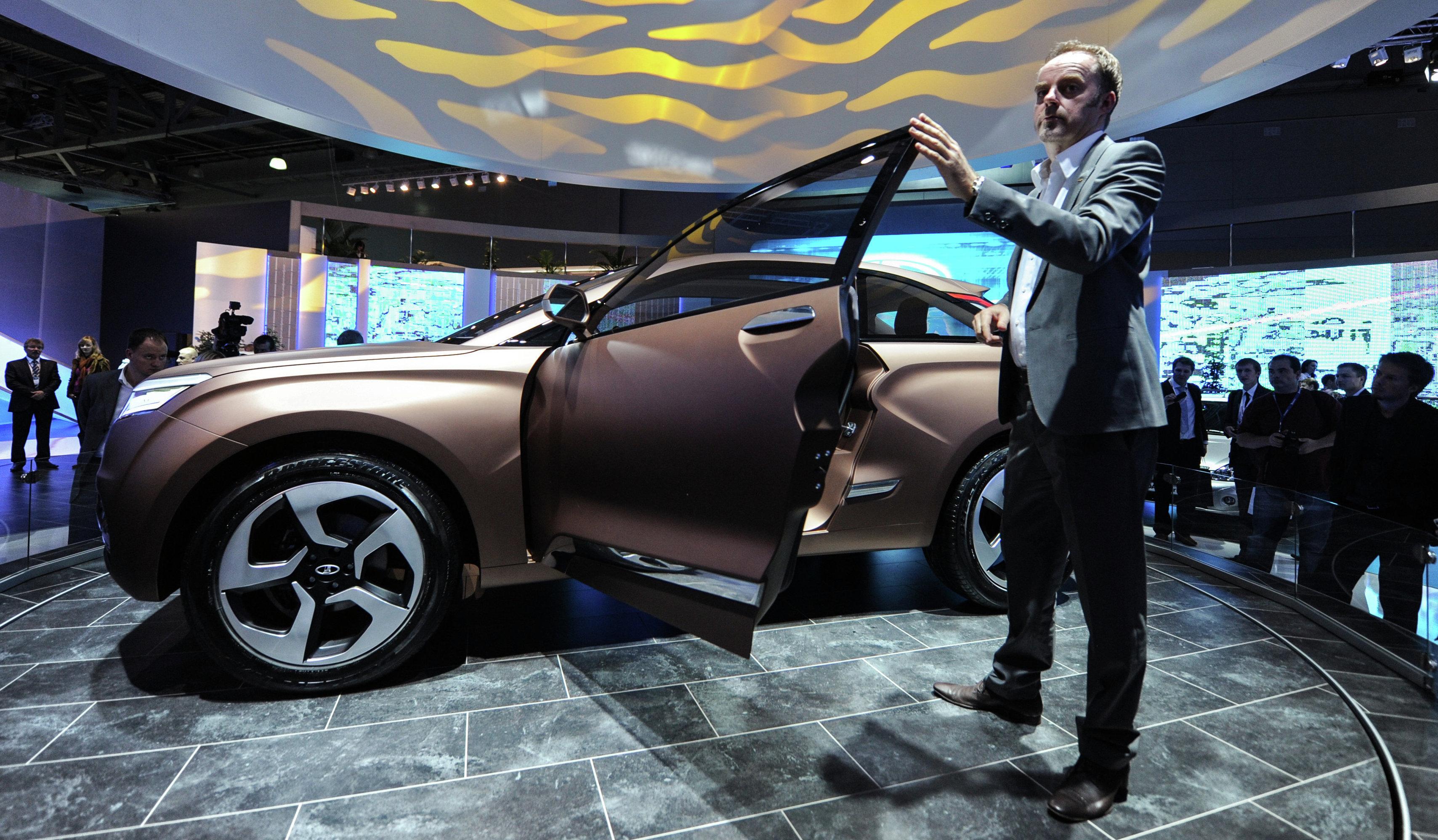 British automotive designer Steve Mattin with his creation, the XRay.