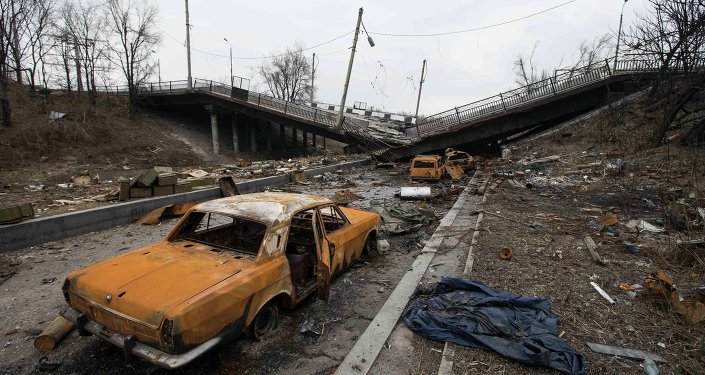 Wrecked cars are pictured near a destroyed bridge near Donetsk airport March 3, 2015