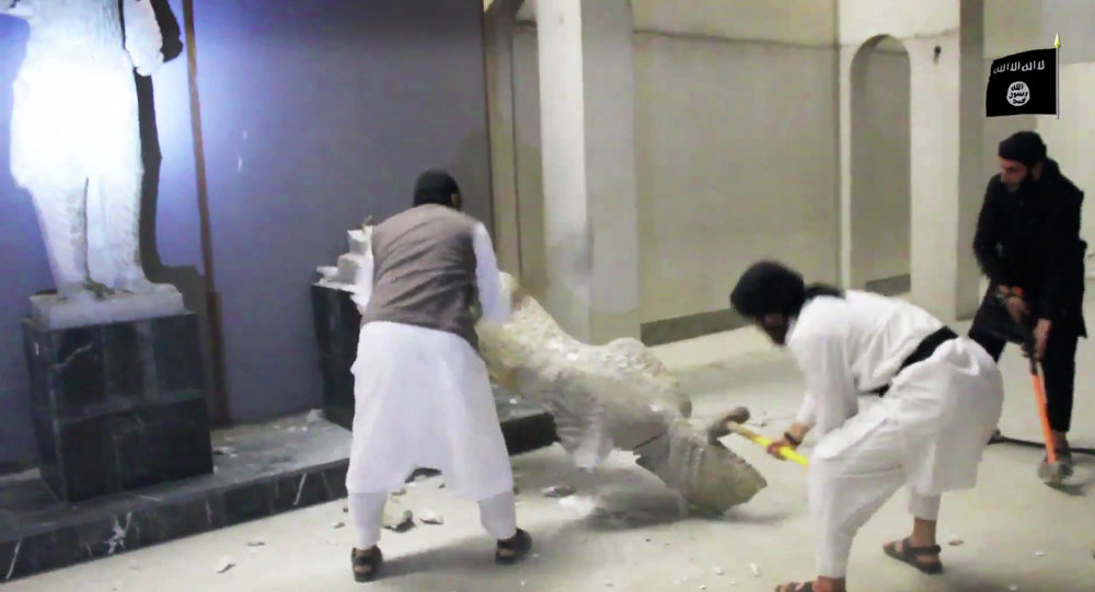 In this image made from video posted on a social media account affiliated with the Islamic State group on Thursday, Feb. 26, 2015, which has been verified and is consistent with other AP reporting, militants take sledgehammers to an ancient artifact in the Ninevah Museum in Mosul, Iraq.