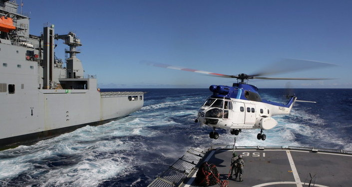 United States Navy Ship (USNS) Cesar Chavez's Super Puma helicopter, conducts a Vertical Replenishment between HMAS Toowoomba, during Operation Southern Indian Ocean, in search of missing Malaysia Airlines Flight MH370