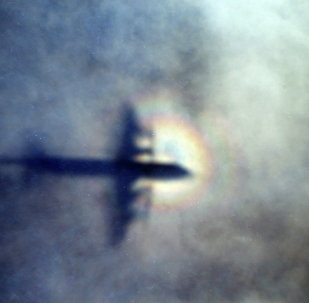 The shadow of a Royal New Zealand Air Force P3 Orion is seen on low level cloud while the aircraft searches for missing Malaysia Airlines Flight MH370 in the southern Indian Ocean, near the coast of Western Australia