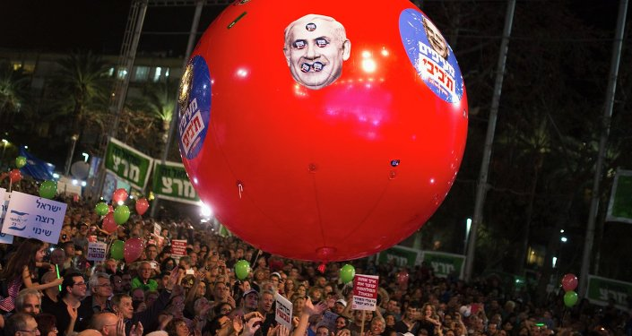 Israelis gather at a rally calling for a change of government and to replace Prime Minister Benjamin Netanyahu, at Rabin Square in Tel Aviv