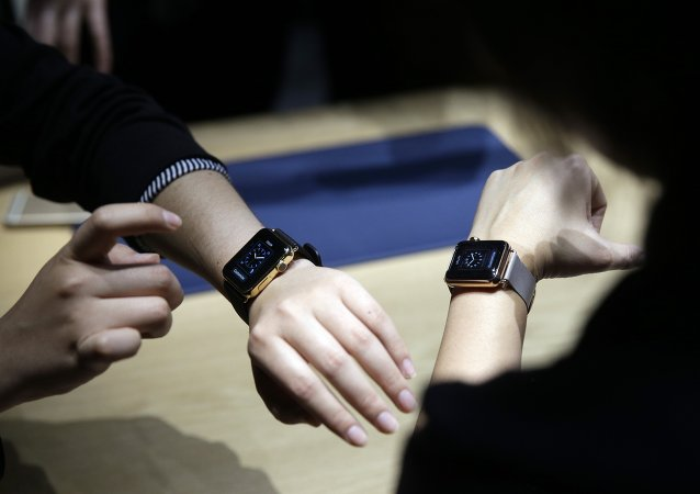 Event attendees get a look at varieties of the new Apple Watch on display in the demo room after an Apple event on Monday, March 9, 2015, in San Francisco.