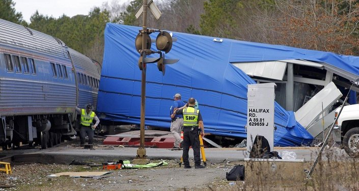 A northbound Amtrak train collided with an oversized truck carrying an electrical building when the truck got stuck on the tracks at the intersection of US Hwy 301 and NC Hwy 903 in Halifax, NC on March 9, 2015