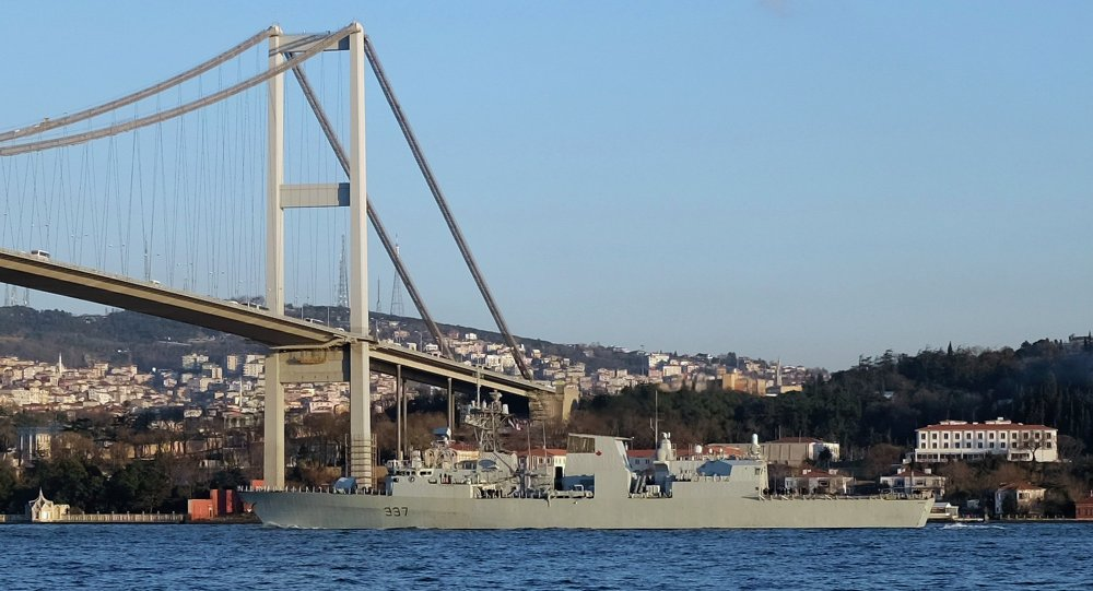 Canadian frigate HMCS Fredericton passes under the Bosphorus bridge in Istanbul, en route to the Black Sea, March 4, 2015.