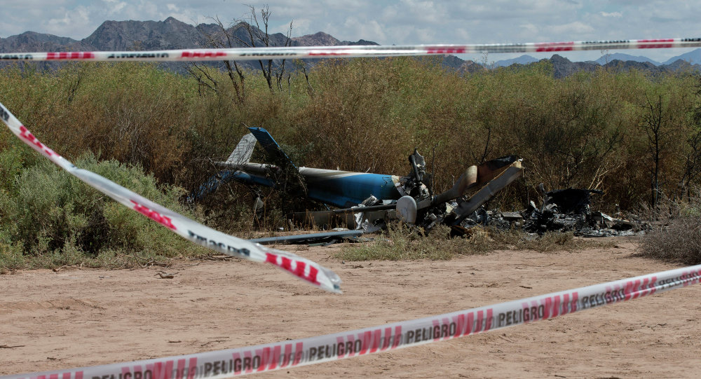 The remains of one of two helicopters that crashed sit on the ground near Villa Castelli, La Rioja province, Argentina
