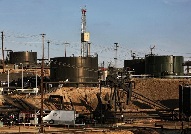 This Thursday March 6, 2014 photo shows pumpjacks operating in front of a hydraulic fracturing site in the Inglewood oil fields in the Baldwin Hills area of Los Angeles
