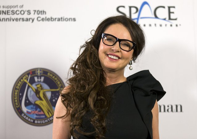 British singer Sarah Brightman poses for pictures during a photocall in London on March 10, 2015