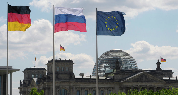 From left to right: Flags of Germany, Russia and the EU