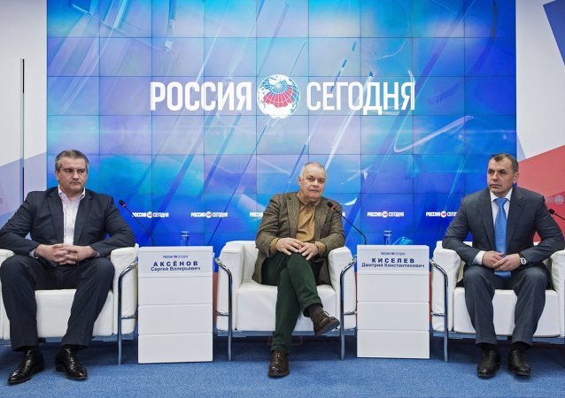 From left: Head of the Republic of Crimea Sergei Aksyonov, Rossiya Segodnya Director General Dmitry Kiselеv and Chairman of the State Council of the Republic of Crimea Vladimir Konstantinov at the opening of Rossiya Segodnya's Multimedia Press Center in Simferopol