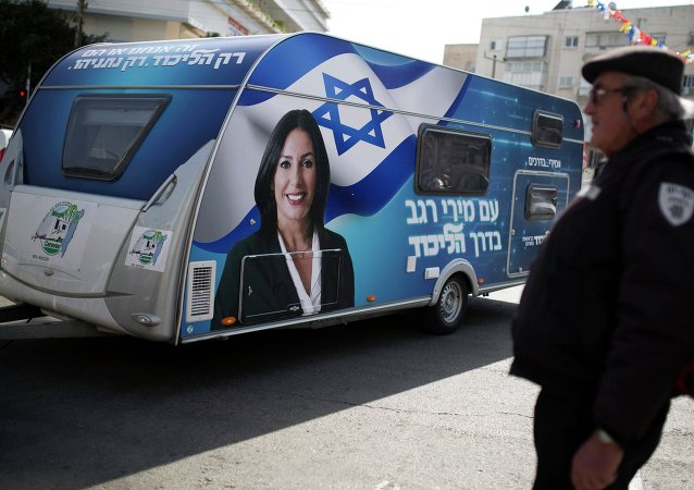 A portrait of Likud legislator Miri Regev is seen on a trailer, used for campaigning, during a stop in Netanya, north of Tel Aviv February 25, 2015
