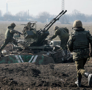 Ukrainian servicemen take position at the front line outside Kurahovo, in the Donetsk region of Ukraine, Wednesday, March 11, 2015