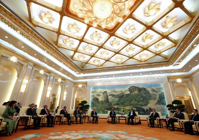 China's President Xi Jinping (4th R) meets with the guests at the Asian Infrastructure Investment Bank (AIIB) launch ceremony at the Great Hall of the People in Beijing in this October 24, 2014