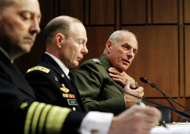 General John F. Kelly, right, speaks before the Senate Armed Services Committee.