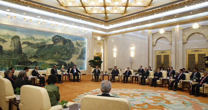 Chinese President Xi Jinping meets with guests of the Asian Infrastructure Investment Bank at the Great Hall of the People in Beijing on October 24, 2014