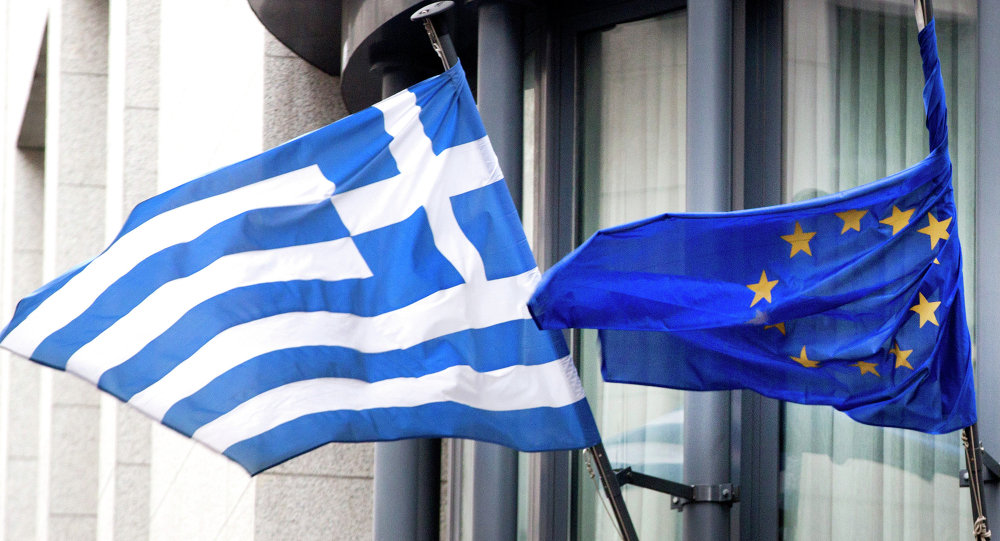 The Greek, left, and EU flag flap in the wind.