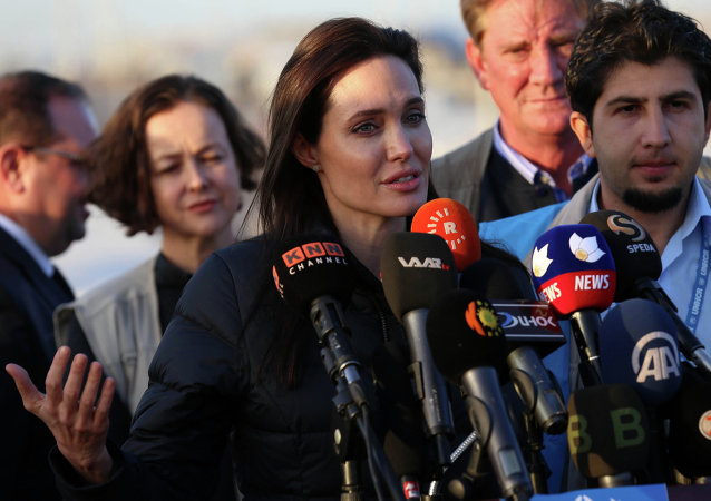 US actress and UNHCR ambassador Angelina Jolie delivers a speech during a visit to a camp for displaced Iraqis in Khanke, a few kilometres (miles) from the Turkish border in Iraq's Dohuk province, on January 25, 2015