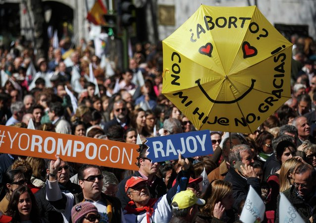 Pro-life demonstrators gather holding signs against abortion and waving flags in central Madrid March 14, 2015