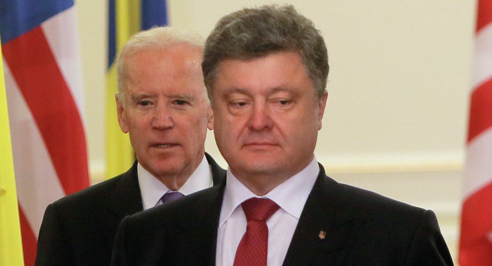 Ukrainian President Petro Poroshenko, right, and US Vice President Joe Biden prior their statement to the media at the Presidential Administration Building in Kiev. File photo