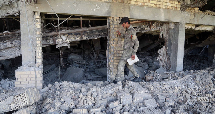 An Iraqi soldier inspects the demolished tomb of former Iraqi president, Saddam Hussein, in Tikrit, 130 kilometers (80 miles) north of Baghdad, Iraq, Sunday, March 15, 2015.