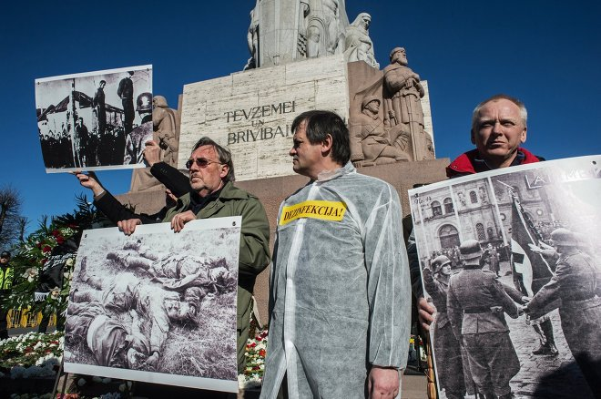 Protesters demonstrate against the annual procession commemorating the Latvian Waffen-SS (Schutzstaffel) unit, also known as the Legionnaires, in Riga March 16, 2015.