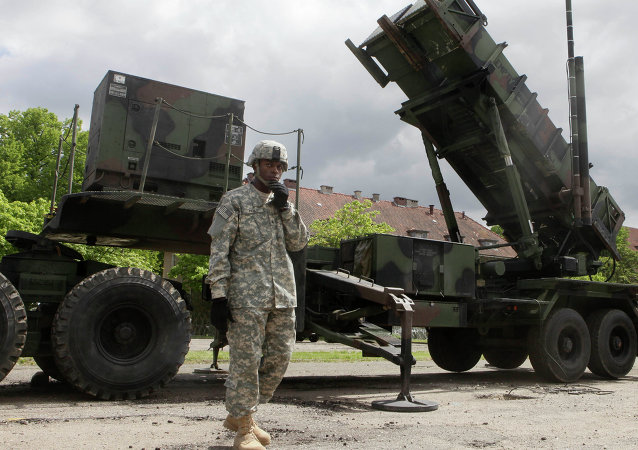 A US soldier stands next to a Patriot surface-to-air missile battery at an army base in Morag, Poland