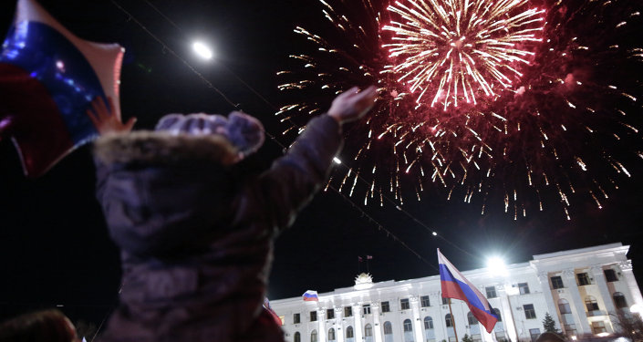 People watch fireworks during a concert marking the one-year anniversary of Crimea voting to leave Ukraine and join the Russian state, in central Simferopol on March 16, 2015