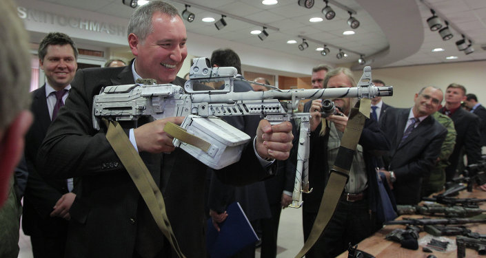 Deputy Prime Minister Dmitry Rogozin, left foreground, inspects new weapons and equipment during a visit to the Central Scientific Research Institute of Precise Mechanical Engineering (TSNIITOCHMASH) in the Moscow region.