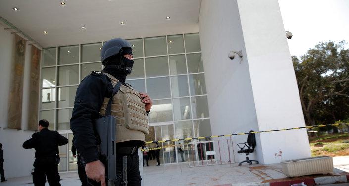 Policemen guard the entrance of the Bardo museum in Tunis, Tunisia