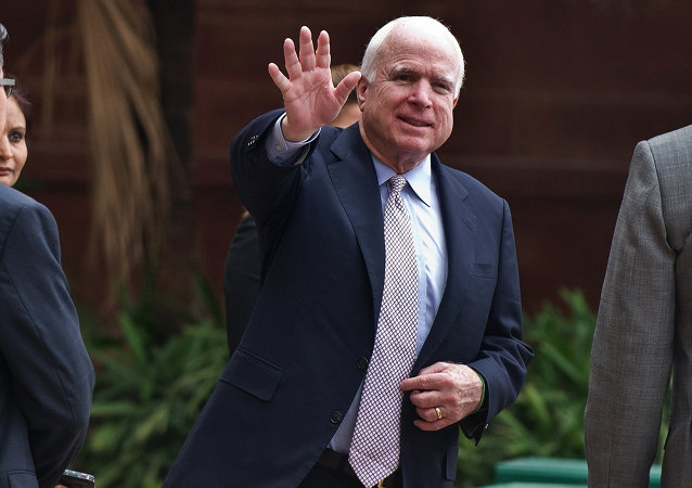 US Senator John McCain waves to the media as he leaves the Ministry of External Affairs in New Delhi