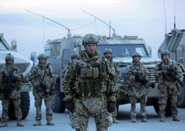 German soldiers stand guard during the NATO Secretary-General Jens Stoltenberg's first visit