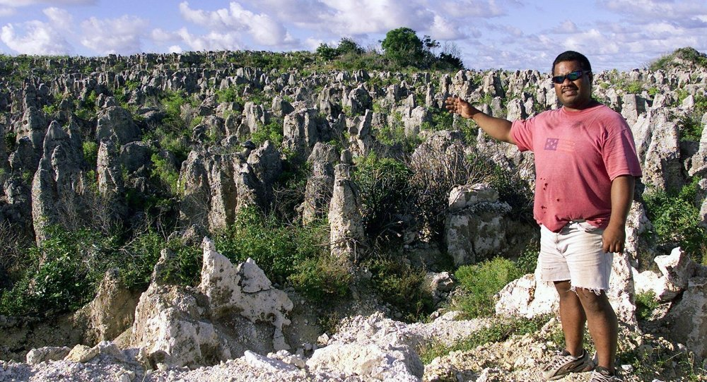 Peter Akubor shows off the moonscape of limestone pinnacles in Nauru, 11 September 2001, where the 521 mainly Afghan refugees who have been refused entry into Australia will be housed