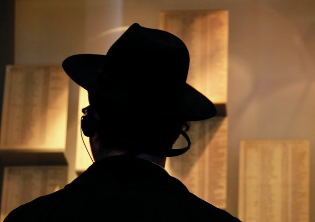 An Ultra-Orthodox Jewish man looks at facsimiles of Oskar Schindler's lists displayed for the public at the Yad Vashem Holocaust memorial museum in Jerusalem