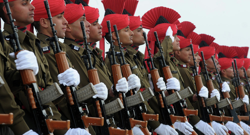 New Indian military recruits stand to attention during a passing-out parade at an Indian Army base on outskirts of Srinagar