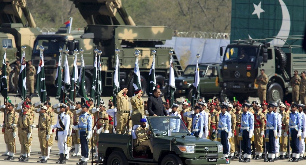 Pakistan's President Mamnoon Hussain inspects the troops during Pakistan Day parade in Islamabad March 23, 2015. Pakistan held its first Republic Day parade in seven years on Monday, full of flag-waving pomp and aerial military expertise, a symbolic show of strength in the war against the Taliban months after a militant attack on a school killed 132 children. Pakistan Day commemorates March 23, 1940, when the Muslim League demanded the establishment of separate nations to protect Muslims in the then British colony of India.