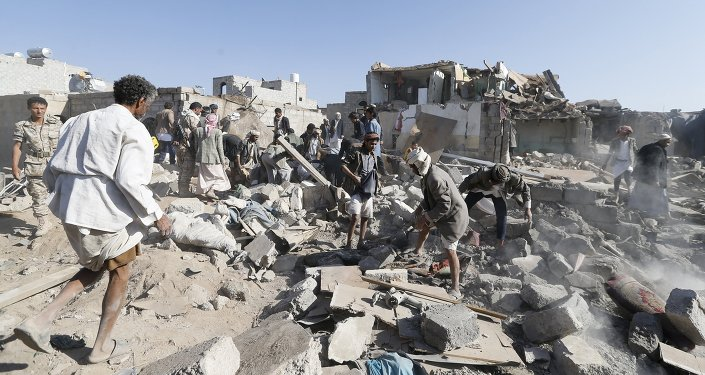 People search for survivors under the rubble of houses destroyed by an air strike near Sanaa Airport March 26, 2015.