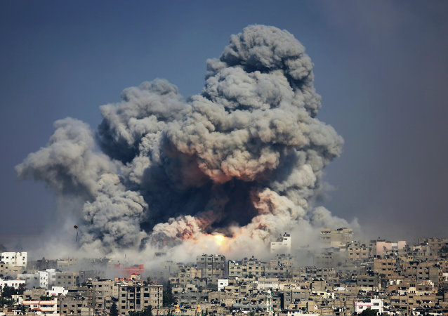 In this July 29, 2014 photo, smoke and fire from an Israeli strike rise over Gaza City. A fierce debate is raging within Israel's military over the extent to which soldiers should be held legally accountable for their actions during last year's Gaza war, with commanders increasingly at odds with military lawyers.