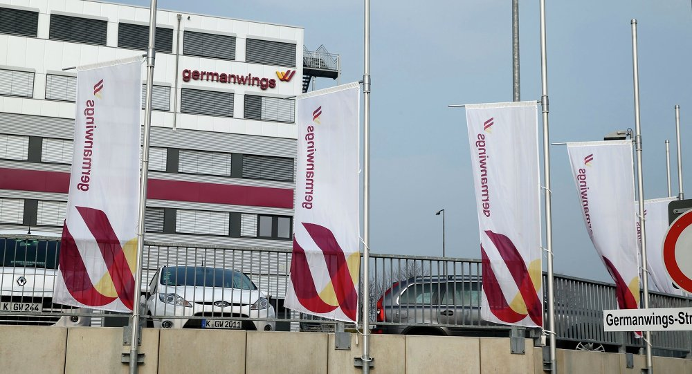 Flags flutter half mast in front of the Germanwings headquarters at Cologne Bonn airport March 24, 2015